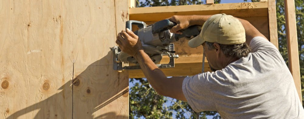 Contractor installing sub siding